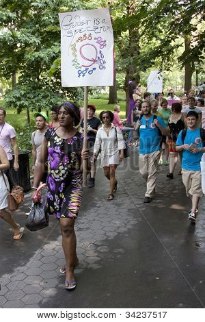 NEW YORK - JUNE 22: Supporters holding signs march through Washington Square Park on the 8th Annual Trans Day of Action on June 22, 2012 in New York City.