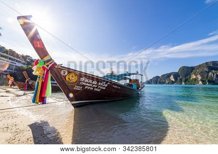 Phi Phi Island,  Thailand - November 26 2019: Traditional Wooden Longtail Boats Parked At A Beach In