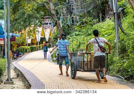 Phi Phi Island, Thailand - November 24 2019: Locals Delivering Goods On A Wheelcart At Phi Phi Islan