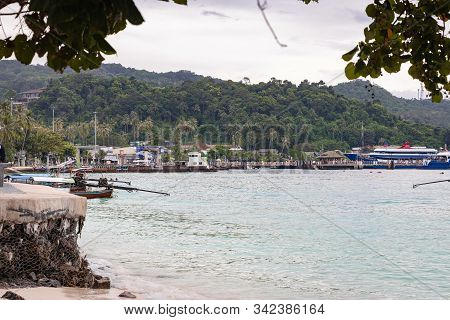 Phi Phi Island, Thailand - November 24 2019: Ferries And Boats Parked At The Pier In Phi Phi Island.