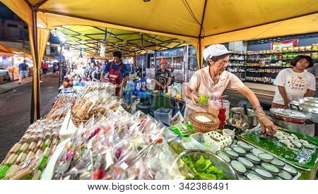 Krabi Town, Thailand - November 23 2019: A Local Woman Selling Street Food In Krabi Weekend Night Ma