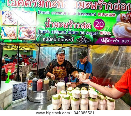 Krabi Town, Thailand - November 23 2019: Locals Selling Coconut Icecream At Krabi Weekend Night Mark