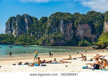 Krabi Town, Thailand - November 23 2019: Tousiting Sunbathing At The Beautiful Railay Beach In Krabi