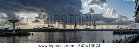 Panoramic View Of Port Of Hamburg From Hafencity Before Sunset With Dramatic Stormy Clouds