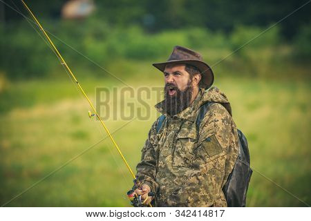Portrait Of Cheerful Senior Man Fishing. Guy Fly Fishing. Catching And Fishing. Male Hobby. Rural Ge