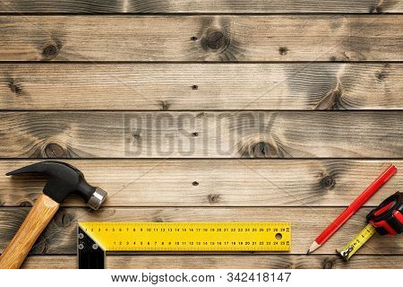 Work Tools For Carpenter On Wooden Background. Carpentry.