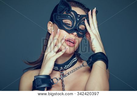 Sensaul Young Brunette Woman In Catwoman Mask And Leather Handcuffs Portrait, Bdsm