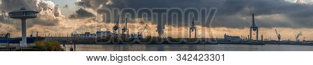 Panoramic View Of Port Of Hamburg From Hafencity During Sunset With Dramatic Stormy Clouds