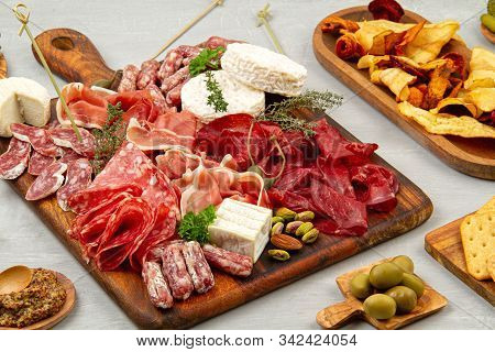 Appetizers Table With Differents Antipasti, Charcuterie, Snacks And Wine. Sausage, Ham, Tapas, Chees