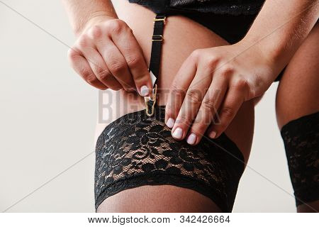 Sexuality And Sensuality Of Women. Part Body Sexy Slim Woman Wear Garter Belt And Stockings Panties.