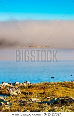 Hardangervidda Mountain Plateau, Norway Landscape. Morning Time, Clouds Over Lake Water. National To