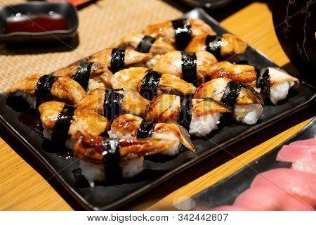 Foie Gras Sushi And Unagi Eel Sushi On Black Tray. Japanese Food Traditional Cuisine