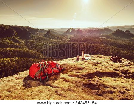 Red Backpack And Prepared Healthy Food Picnic In Pure Nature. Sandstone Cliff With Sandwiches , Frui