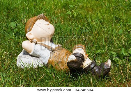 Young boy sleep in the grass