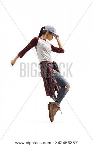 Young trendy casual female dancing on tiptoes isolated on white background