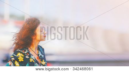 Beautiful Young Woman Relaxing And Enjoying Sun At Sunset. Beauty Sunshine Girl Side Profile Portrai