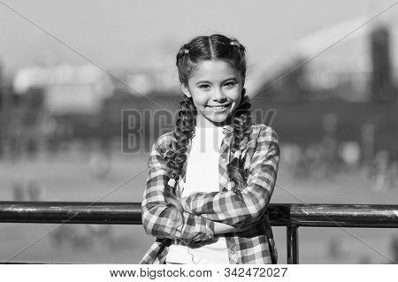 Girl Cute Kid With Braids Relaxing Urban Background Defocused. Organize Activities For Teenagers. Va