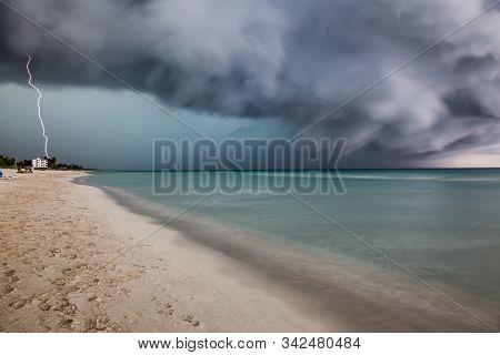 Varadero, Cuba. Thunder And Lightening Storm Passing Over The Sandy Beach Near The Caribbean Sea.