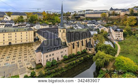 Birds Eye Aerial View Of The Neumunster Abbey In The Unesco World Heritage Site, Old Town Of Luxembo