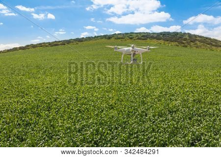 Drone Unmanned Aircraft Flying and Gathering Data Over Country Farmland.