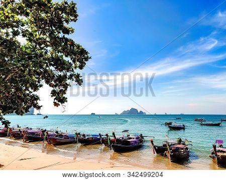 Krabi Town, Thailand - November 23 2019: Traditional Longtail Boats Parked At Ao Nang Beach In Krabi