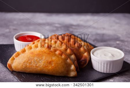 Fied Meat Pies Empanadas Cheburek With Dips On The Black Plate.
