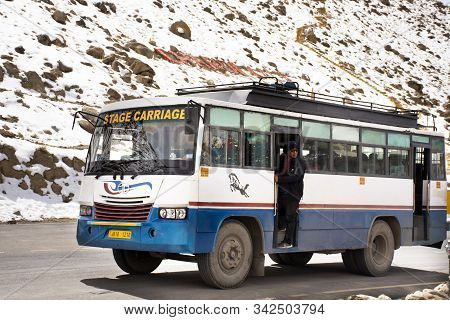 Jammu Kashmir, India - March 20 : Indian People Driver Driving Bus Send And Receive Passengers At Gu