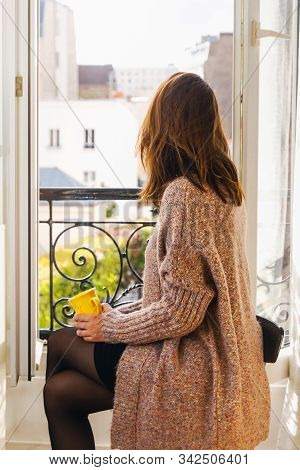 Woman Drinking Coffee At Home. Woman Relaxing With Coffee At Home. Modern Lifestyle. Beautiful Woman
