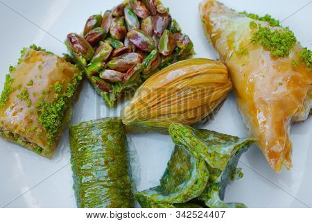 Turkish Baklava With Pistachios.  Traditional Turkish Dessert. Antep Baklava On White Background. So