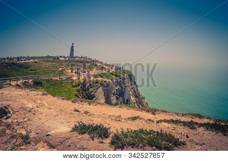 Portugal, Cabo Da Roca, The Western Cape Roca Of Europe, A Group Of Tourists  On The Cape Roca, Land