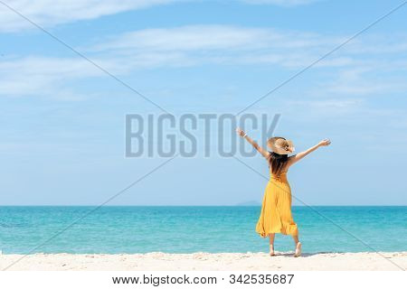 Summer Holiday. Lifestyle Woman Chill Holding Big White Hat And Wearing Yellow Dress Fashion Summer