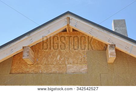 Attic Insulation Outdoor. Rooftop House Attic Insulation With Rock Wool.