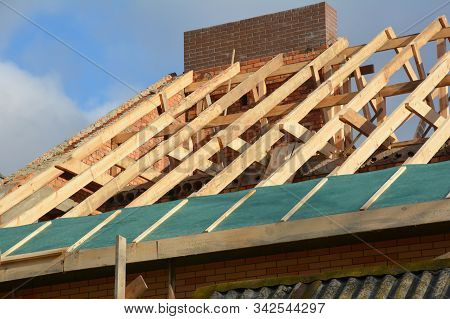 House Rooftop Wooden Frame Construction. Incomplete House Rooftop Roofing Construction Trusses, Vapo