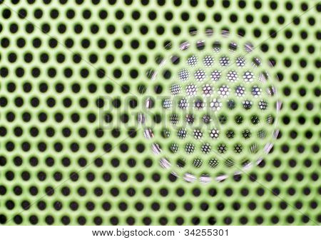 Beautiful Close Up Net Texture Of Green Sound Speaker