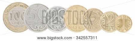 A Full Set Of Kazakh Tenge Coins Stand In A Row One After Another. Isolated Over White Background.