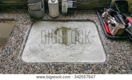 Overflowing Kitchen Sink, Clogged Drain, Blocked Drain.