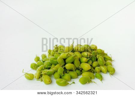 Raw Green Fresh Chickpeas. Heap Of Legume Chickpea Background. Top View. Free Space For Your Text