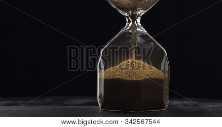 Sand Moves Through Hourglass. Close Up Of Hour Glass Clock. Old Time Classic Sandglass Timer. Closeu