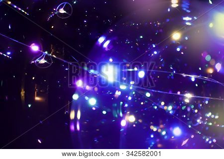 Colored Lights On A Dark Background. Bokeh Festive Abstract Dark Background. Space Emulation
