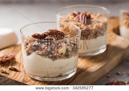 Parfait. Granola Parfait. Delicious Natural Yogurt Parfait With Caramel, Pecan Nuts On Conctere Back
