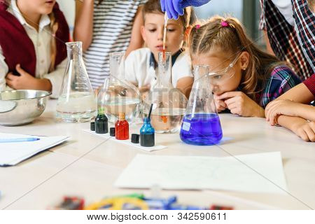 Test Tubes With Colorful Liquid Substances. Study Of Liquid States. Group School Pupils With Test Tu
