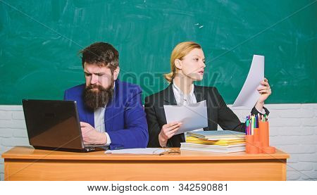 Teacher And Student On Exam. Business Couple Use Laptop And Documents. Back To School. Formal Educat