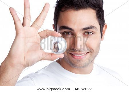 Portrait of young man holding crystal ball isolated on white background.
