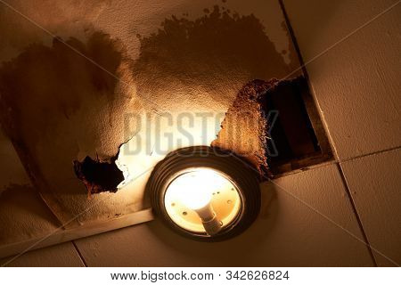 rooftop leakage cause the ceiling with hole