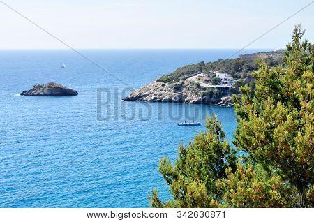 a view of the Mediterranean sea at Cala Vedella beach in Sant Josep de Sa Talaia, in Ibiza Island, Balearic Islands, Spain