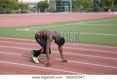 Bronx, New York/usa - August 5, 2019: Black Male Doing Running Exercise At Stadium Track. This Was N