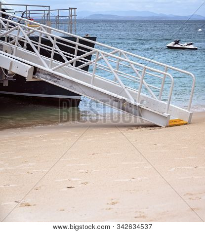 Cruise Catamaran Ramp Onto The Sand To Allow Passengers To Get Off Onto The Sandy Beach Of An Island