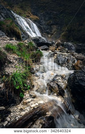 Nature Rainforest River Cascade. Mountain Stream In Nature. Spring Stream In Mountain Nature. Nature