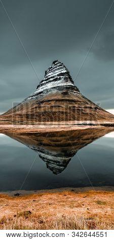 Beautiful Kirkjufell Mountain Reflection In The Lake