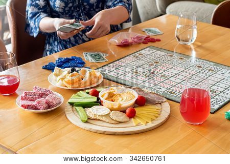 Sydney, Australia 2019-12-04 Friends Ready To Play Sequence Board Game With Color Chips And Playing